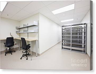 Empty Metal Shelves And Workstations Canvas Print by Jetta Productions, Inc
