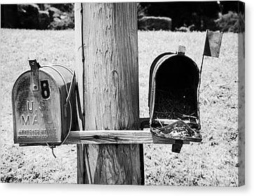 empty old used american private mailboxes one with birdsnest in Lynchburg tennessee usa Canvas Print by Joe Fox