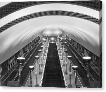 Escalators In A Tube Station Canvas Print by Maynard Owen Williams