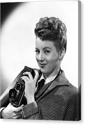 Evelyn Keyes, With A Rolex Camera, Ca Canvas Print by Everett