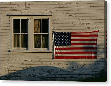 Evening Light On An American Flag Canvas Print by Stephen St. John