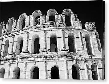 External View Of Three Upper Tiers Of Archways Of Old Roman Colloseum El Jem Tunisia Canvas Print by Joe Fox