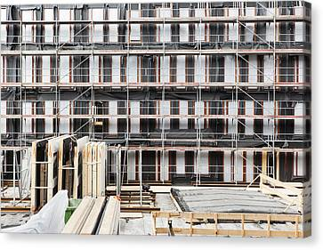 Facade Of Buildings Under Construction Canvas Print by Corepics