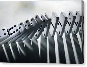 Falling Dominoes Canvas Print by Victor De Schwanberg
