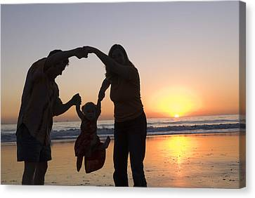 Family Portrait On The Beach At Sunset Canvas Print by Rich Reid