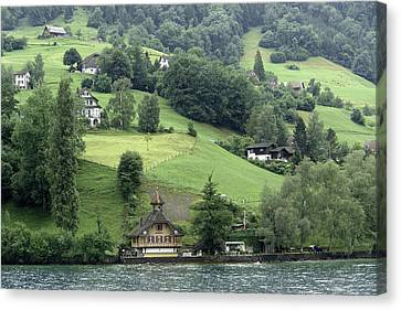 Few Houses On The Slope Of Mountain Next To Lake Lucerne Canvas Print by Ashish Agarwal