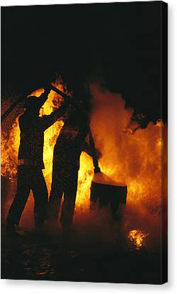 Firefighters Are Engulfed In Flames Canvas Print by Stephen Alvarez