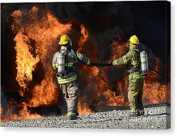 Firefighters In Action 3 Canvas Print by Bob Christopher