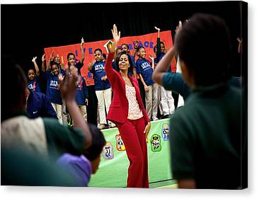 First Lady Michelle Obama Exercises Canvas Print by Everett