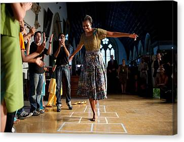 First Lady Michelle Obama Plays Canvas Print by Everett