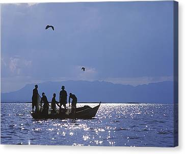 Fishermen Pulling Fishing Nets On Small Canvas Print by Axiom Photographic