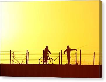 Fishing At Sunset Canvas Print by Dennis Pintoski