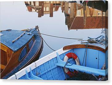 Fishing Boats And Reflection Of Houses Canvas Print by Axiom Photographic