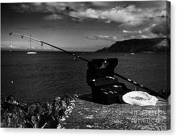 Fishing Tackle Box Filled With Sea Fishing Gear Rod And Bait On The County Antrim Coast Canvas Print by Joe Fox