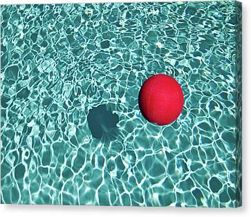 Floating Red Ball In Blue Rippled Water Canvas Print by Mark A Paulda