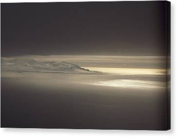 Fog And Sunlight Over Polar Canvas Print by Gordon Wiltsie