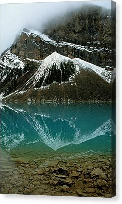 Fog Has Lifted From Lake Louise Canvas Print by Raymond Gehman