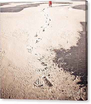 Footprints In The Snow Canvas Print by Christina Klausen