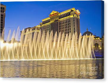 Fountains Of Bellagio In Front Of Caesar's Palace Hotel And Casi Canvas Print by Andre Babiak