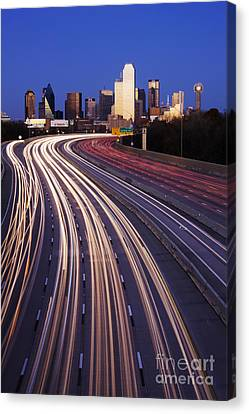 Freeway Traffic At Dusk On I-30 Canvas Print by Jeremy Woodhouse