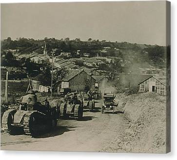 French Tanks Passing Through Rampont Canvas Print by Everett