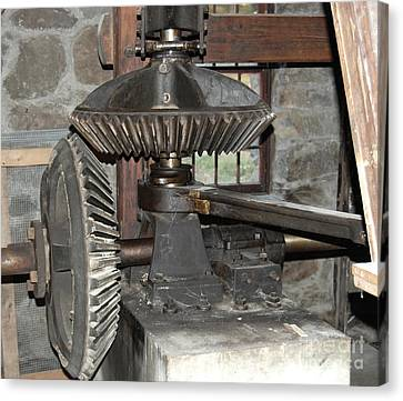 Gears Of The Old Grist Mill Canvas Print by John Small