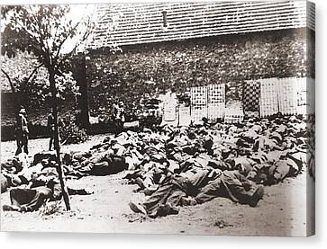 German Soldiers Standing By Corpses Canvas Print by Everett