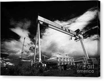 Giant Harland And Wolff Cranes Goliath Amd Samson With Wind Turbine Blades At Shipyard Titanic Canvas Print by Joe Fox