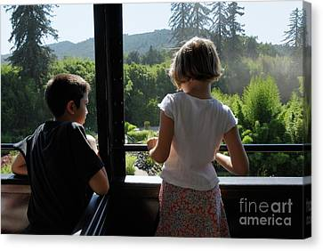 Girl And Boy Looking Out Of Train Window Canvas Print by Sami Sarkis
