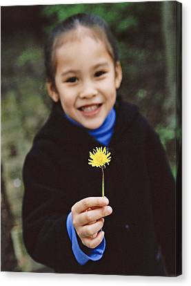 Girl Holding A Flower Canvas Print by Ian Boddy