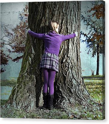 Girl Hugging Tree Trunk Canvas Print by Joana Kruse