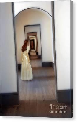 Girl Looking Down Hallway With Multiple Doorways Canvas Print by Jill Battaglia