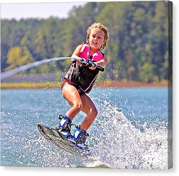 Girl Trick Skiing Canvas Print by Susan Leggett