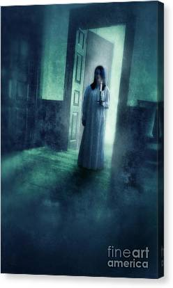 Girl With Candle In Doorway Canvas Print by Jill Battaglia