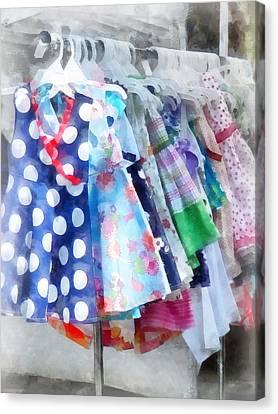 Girl's Dresses At Street Fair Canvas Print by Susan Savad
