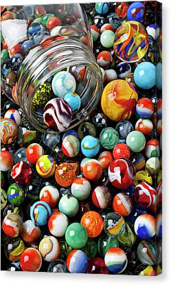 Glass Jar And Marbles Canvas Print by Garry Gay
