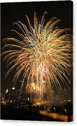 Golden Fireworks Over Minneapolis Canvas Print by Heidi Hermes