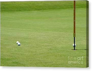 Golf Balls Near Flagstick Canvas Print by Henrik Lehnerer