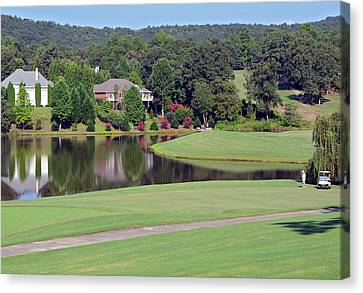 Golfer At Lake  Canvas Print by Susan Leggett