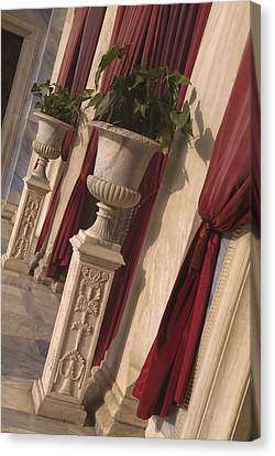 Greek Urns And Red Drapes At Entrance Canvas Print by Richard Nowitz