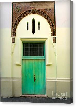 Green Spanish Doors Canvas Print by Perry Webster