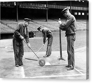 Groundskeepers Preparing Home Plate Canvas Print by Everett