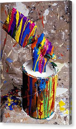 Hand Coming Out Of Paint Bucket Canvas Print by Garry Gay