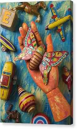 Hand Holding Butterfly Toy Canvas Print by Garry Gay