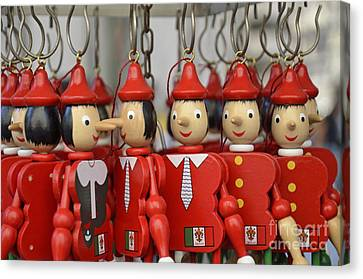 Hanging Pinocchios Puppets Canvas Print by Sami Sarkis