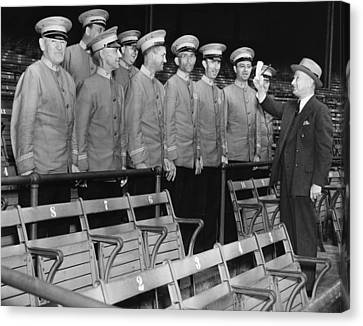 Head Usher Giving Instructions Canvas Print by Everett