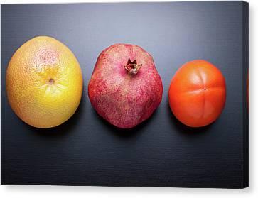 Healthy Fruits On Dark Wooden Background Canvas Print by daitoZen