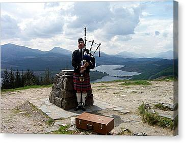 Highland Piper Canvas Print by Kevin Askew