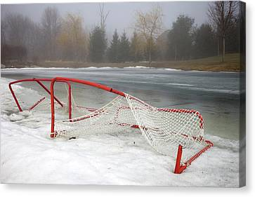 Hockey Net On Frozen Pond Canvas Print by Perry McKenna Photography
