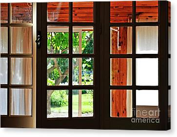 Home Garden Through Window Canvas Print by Sami Sarkis